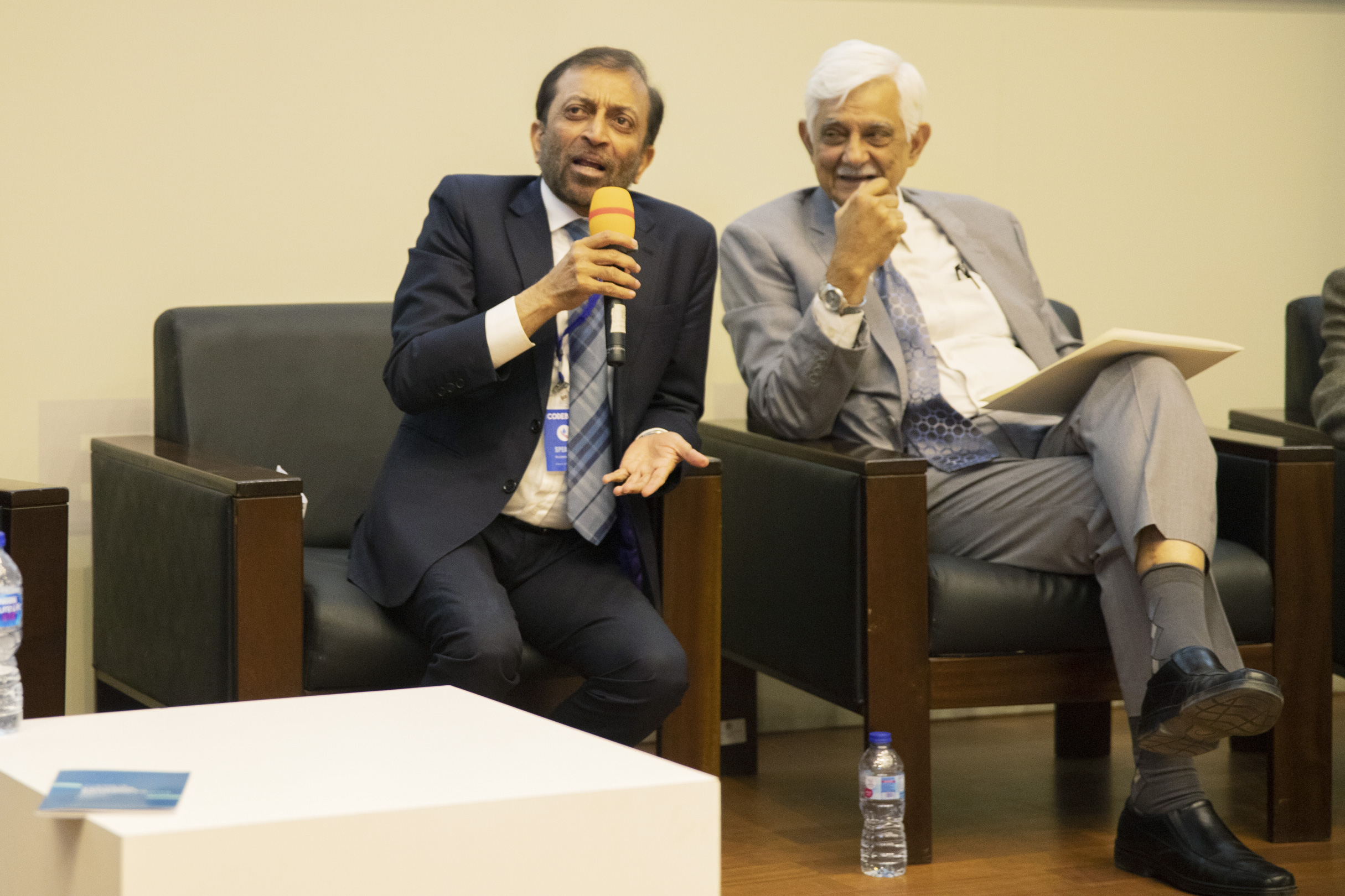 Farooq Sattar and Taj Haider during a panel discussion.